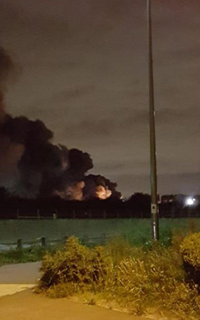 """Smoke billowing into the air as five fuel tankers are on fire in a """"major incident"""" on an industrial estate in Purfleet, Essex - Credit: @deanthurrockrfc/Twitter"""
