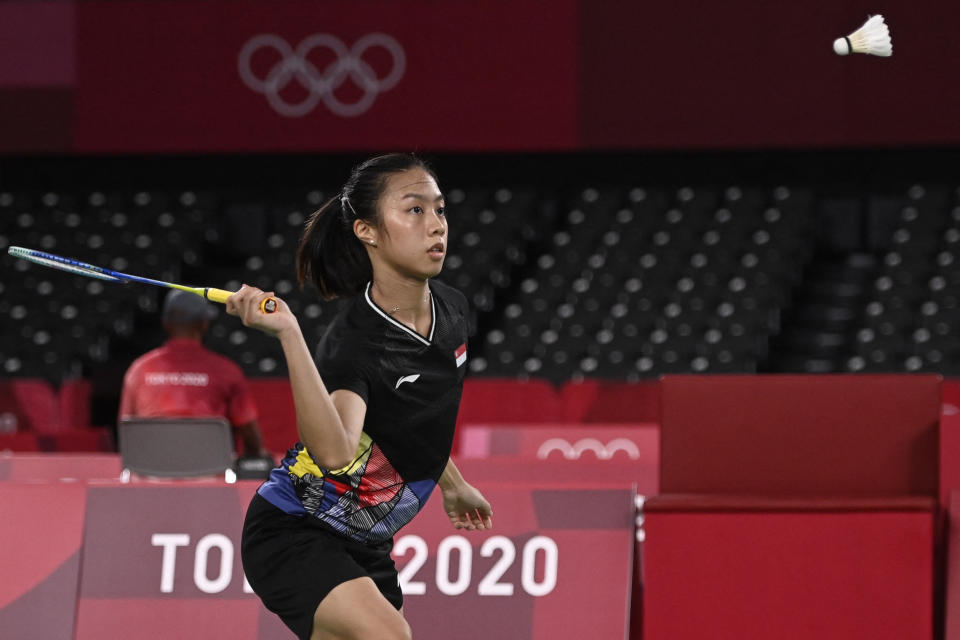 Singapore shuttler Yeo Jia Min hits a shot to Mexico's Haramara Gaitan in their women's singles badminton group stage match during the 2020 Tokyo Olympics.