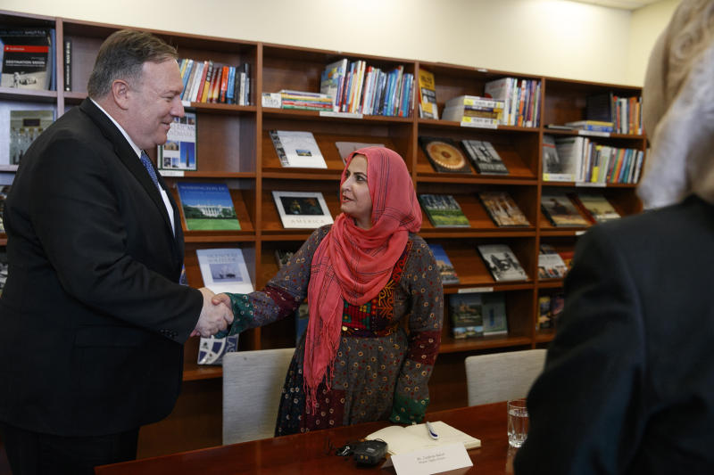 Secretary of State Mike Pompeo, left, shakes hands with Zarghona Baloch, a women's rights activist, as he meets with representatives from Afghan civil society, Tuesday, June 25, 2019, during an unannounced visit to Kabul, Afghanistan. (AP Photo/Jacquelyn Martin, Pool)
