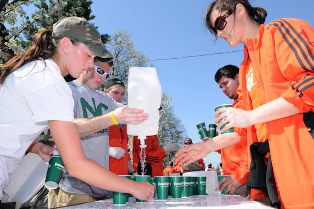HOPKINTON, MA - APRIL 16: Volunteers prepare cups of water for runners at the start of the 116th running of the Boston Marathon April 16, 2012 in Hopkinton, Massachusetts. (Photo by Darren McCollester/Getty Images)