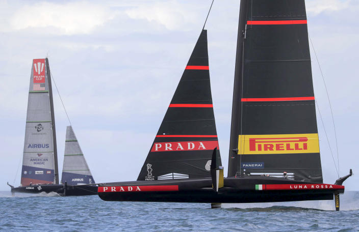 United States' American Magic, left, sails against Italy's Luna Rossa on the third day of racing of the America's Cup challenger series on Auckland's Waitemate Harbour, New Zealand, Sunday, Jan. 17, 2021. (Michael Craig/NZ Herald via AP)
