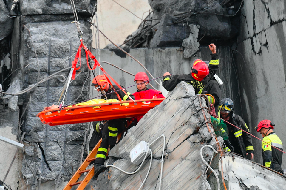 <em>Rescue workers pull an injured person out of the rubble (AP)</em>