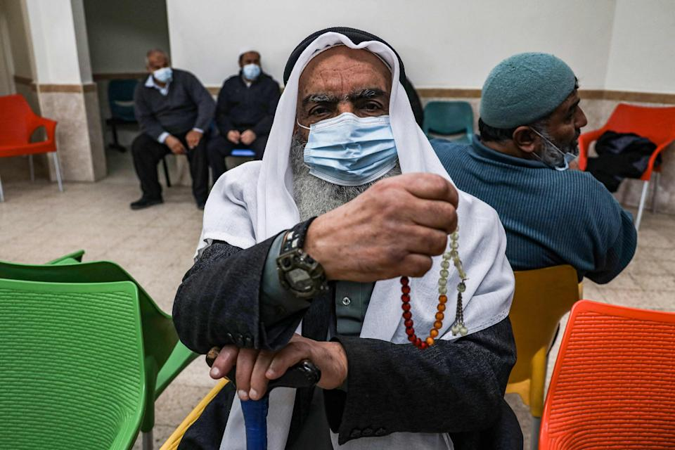 An elderly Palestinian waits to receive a dose of COVID-19 coronavirus vaccine at a clinic in Gaza City (AFP via Getty Images)