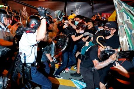 FILE PHOTO: Riot police try to disperse anti-extradition bill protesters after a march at Hong Kong's tourism district Nathan Road near Mongkok