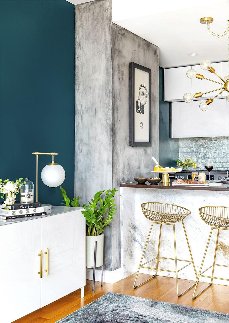 """<p>Bring different textures into your space by painting a concrete-inspired wall. Once you gather your grey paint, dry paintbrush, and lint-free cloth, follow a forgiving buffing technique until you nail your desired look. </p><p><strong>RELATED:</strong> <a href=""""https://www.goodhousekeeping.com/home/renovation/advice/a18680/how-to-paint-a-room/"""" rel=""""nofollow noopener"""" target=""""_blank"""" data-ylk=""""slk:How to Paint a Room"""" class=""""link rapid-noclick-resp"""">How to Paint a Room </a></p>"""