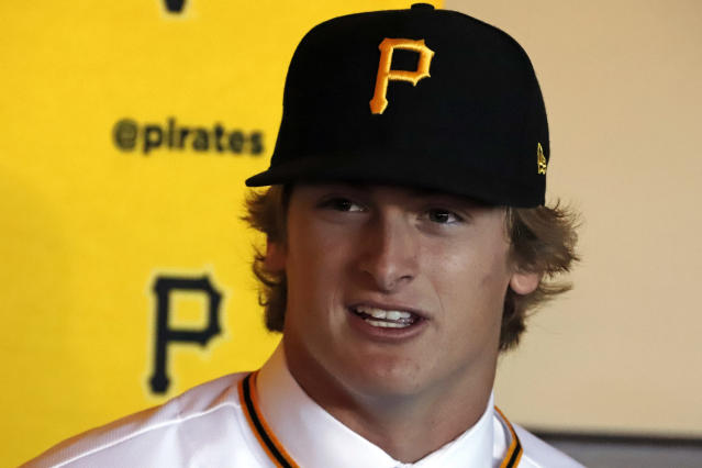 Pittsburgh Pirates first-round draft pick, Quinn Priester, a right-handed pitcher out of Cary-Grove High School in Cary, Illinois, answers questions after putting on his uniform shirt and cap after signing with the team at PNC Park in Pittsburgh, Tuesday, June 11, 2019. (AP Photo/Gene J. Puskar)
