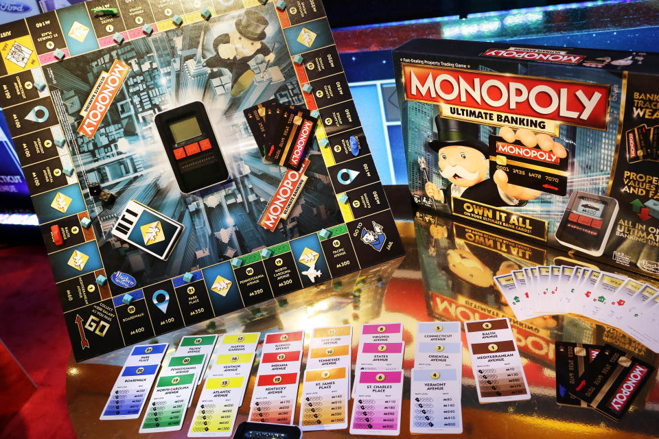 FILE - In this Monday, Feb. 15, 2016, file photo, the Monopoly Ultimate Banking Game from Hasbro is displayed at Toy Fair in New York. The critical holiday shopping season, coupled with quarantining amid the ongoing coronavirus pandemic, pushed board game sales up 21% at Hasbro in the fourth quarter. (AP Photo/Mark Lennihan, File)