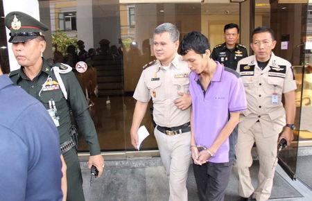 Thanakorn Siripaiboon is escorted by police outside military court in Bangkok December 14, 2015. REUTERS/Dailynews