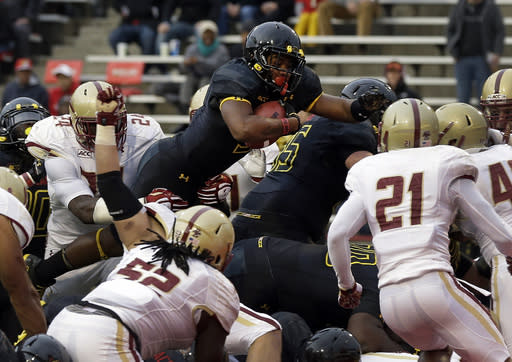 Maryland running back Albert Reid, top center, leaps into the end zone for a touchdown in the first half of an NCAA college football game against Boston College in College Park, Md., Saturday, Nov. 23, 2013. (AP Photo/Patrick Semansky)