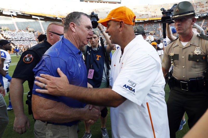 Georgia State head coach Shawn Elliott, left, is congratulated by Tennessee head coach Jeremy Pruitt after a win an NCAA college football game Saturday, Aug. 31, 2019, in Knoxville, Tenn. (AP Photo/Wade Payne)