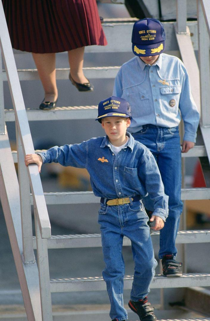 """<p>Harry and William, in their Canadian tuxedo best, visit Queen Elizabeth II's ship, """"Ottawa,"""" during a trip to Toronto. Note the adorable Velcro shoes they're both sporting. </p>"""