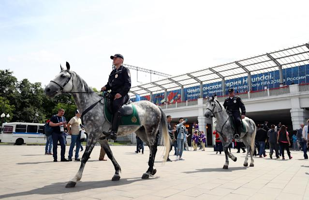 <p>Security on patrol outside the Luzhniki Stadium ahead of the opening match of the 2018 FIFA World Cup </p>