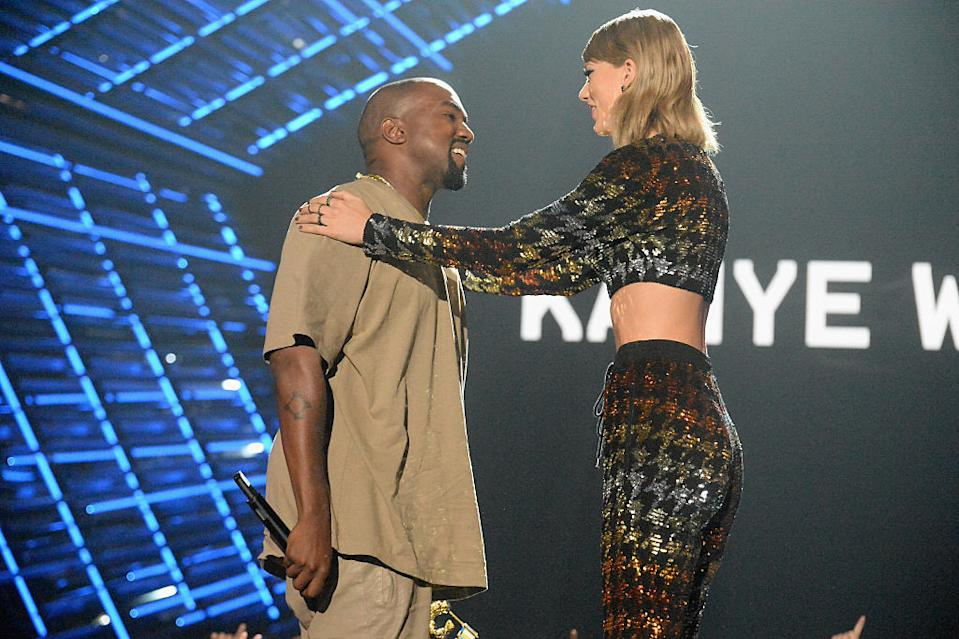 Kanye West accepts the Michael Jackson Video Vanguard Award from Taylor Swift during the 2015 MTV Video Music Awards on Aug. 30, 2015, in L.A. (Photo: Jeff Kravitz/MTV1415/FilmMagic)