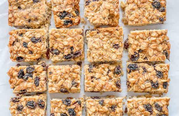 """<p>Perfect for children with an egg allergy and low in sugar, these easy-to-make oat slices are a great lunch box addition. You'll be adding these to your own work packed lunch too. For the full recipe, visit <a href=""""https://mykidslickthebowl.com/easy-oat-slice/"""" rel=""""nofollow noopener"""" target=""""_blank"""" data-ylk=""""slk:My Kids Lick The Bowl"""" class=""""link rapid-noclick-resp"""">My Kids Lick The Bowl</a>. </p>"""