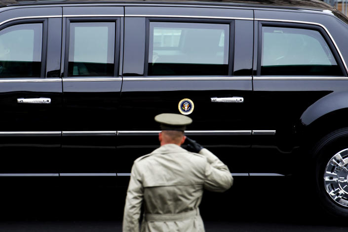 <p>A member of the Army salutes as the Presidential motorcade drives on Pennsylvania Avenue to the Capitol for the Inauguration of President-elect Donald Trump in Washington, Friday, Jan. 20, 2017. (Photo: Cliff Owen/AP) </p>