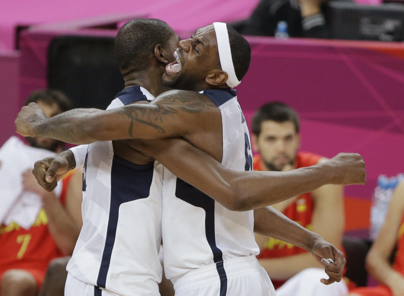 United States' Kevin Durant, left, and LeBron James celebrate during the men's gold medal basketball game against Spain at the 2012 Summer Olympics, Sunday, Aug. 12, 2012, in London. United States won the game 107-100. (AP Photo/Matt Slocum)