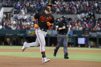 Baltimore Orioles' Rio Ruiz rounds the bases after hitting a home run during the fourth inning of the team's baseball game against the Texas Rangers in Arlington, Texas, Friday, April 16, 2021. (AP Photo/Roger Steinman)