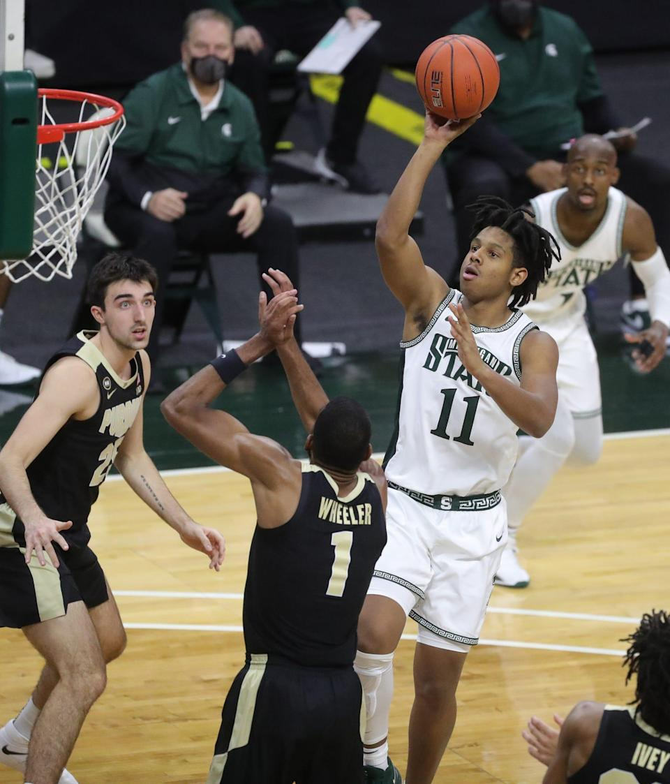Michigan State Spartans guard A.J. Hoggard shoots against Purdue Boilermakers forward Aaron Wheeler during the second half at Breslin Center in East Lansing, Friday, Jan. 8, 2021.