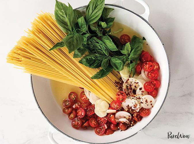 """<h2>14. One-Pot Tomato Basil Pasta</h2> <p>The sauce and pasta cook together in the same pot. We'll see you in 20.</p> <p><a class=""""link rapid-noclick-resp"""" href=""""https://www.purewow.com/recipes/one-pot-tomato-basil-pasta"""" rel=""""nofollow noopener"""" target=""""_blank"""" data-ylk=""""slk:Get the recipe"""">Get the recipe</a></p>"""