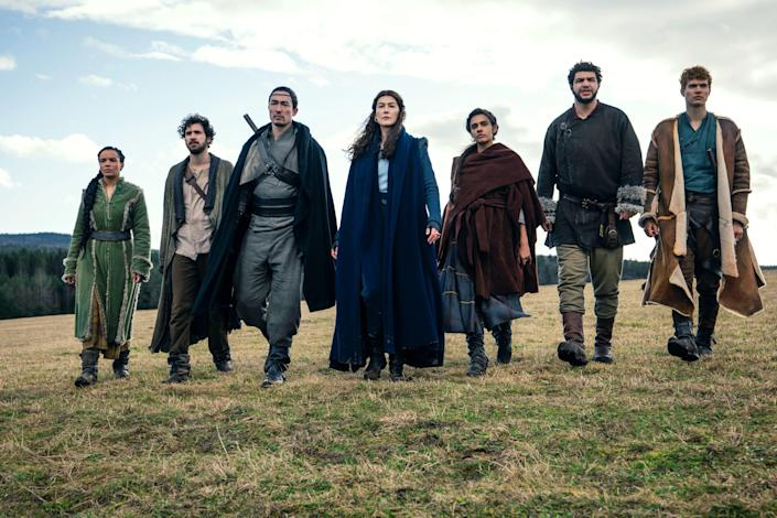 """There's a new generation of fantasy adventuring young adults in Amazon's """"Wheel of Time"""" adaptation. Zoë Robins as Nynaeve al'Meara, Barney Harris as Mat Cauthon, Daniel Henney as Lan, Rosamund Pike as Moiraine Sedai, Madeleine Madden as Egwene al'Vere, Marcus Rutherford as Perrin Aybara and Josha Stradowski as Rand al'Thor  in an episode of the series."""