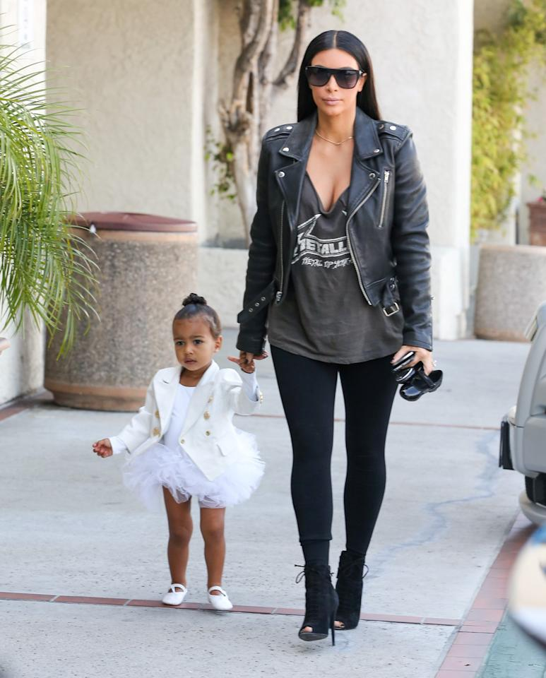 <p>Looking angelic on the way to ballet class while contrasting with mom's edgy-rock look. (Photo: Getty Images) </p>
