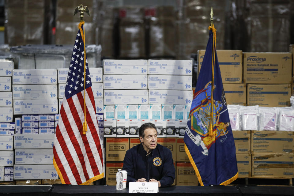 FILE - In this March 24, 2020 file photo, Gov. Andrew Cuomo speaks during a news conference against a backdrop of medical supplies at the Jacob Javits Center that will house a temporary hospital in response to the COVID-19 outbreak in New York. (AP Photo/John Minchillo, File)