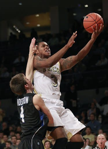 Georgia Tech's Marcus Georges-Hunt (3) is fouled by Presbyterian guard Austin Anderson (4) as he drives to the basket in the first half of an NCAA college basketball game on Wednesday, Nov. 14, 2012, in Atlanta. (AP Photo/John Bazemore)
