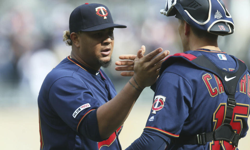 Minnesota Twins' relief pitcher Adalberto Mejia, left, and catcher Jason Castro celebrate their victory over the Baltimore Orioles in a baseball game Saturday, April 27, 2019, in Minneapolis. (AP Photo/Jim Mone)