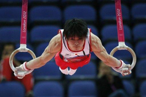 """Japan's gymnast Kohei Uchimura compete on the rings during the London Olympics artistic gymnastics men's qualification on July 28. We were all more or less thinking about how the Chinese were going to perform, so it might have affected our performance,"""" he said"""