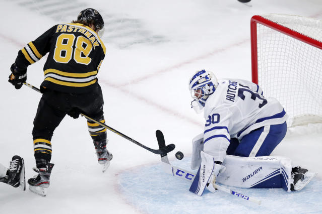 Boston Bruins right wing David Pastrnak (88) backhands the puck from between his legs to score against Toronto Maple Leafs goaltender Michael Hutchinson (30) during the first period of an NHL hockey game in Boston, Tuesday, Oct. 22, 2019. (AP Photo/Charles Krupa)