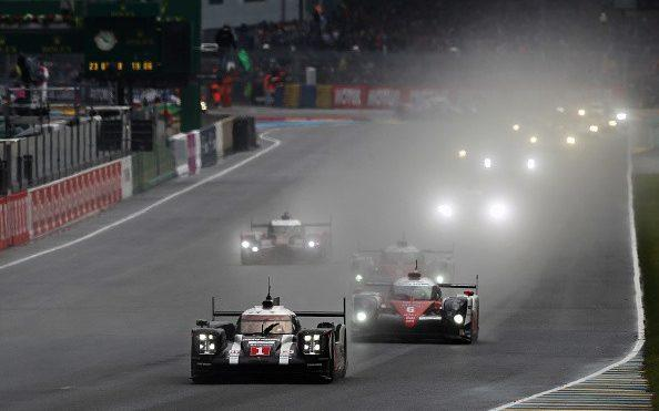LE MANS, FRANCE - JUNE 18: The Porsche Team 919 Hybrid of Mark Webber, Brendon Hartley and Timo Bernhard drives at the start of the Le Mans 24 Hour race at the Circuit de la Sarthe on June 18, 2016 in Le Mans, France. (Photo by Ker Robertson/Getty Images) - Credit: Ker Robertson/Getty Images Europe
