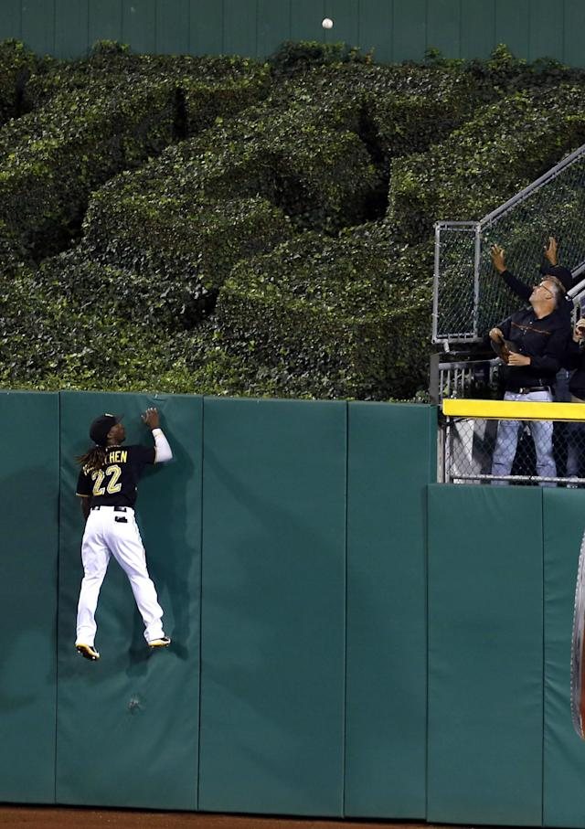 Pittsburgh Pirates center fielder Andrew McCutchen (22) looks for the ball hit by Chicago Cubs' Brian Bogusevic that went for a two-run home run in the fourth inning of a baseball game on Friday, Sept. 13, 2013, in Pittsburgh. (AP Photo/Keith Srakocic)