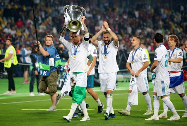 Soccer Football - Champions League Final - Real Madrid v Liverpool - NSC Olympic Stadium, Kiev, Ukraine - May 26, 2018 Real Madrid's Sergio Ramos celebrates winning the Champions League with the trophy and team mates REUTERS/Hannah McKay