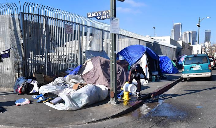 Tents where homeless residents sleep line a sidewalk near downtown Los Angeles on Jan. 8. (Photo: FREDERIC J. BROWN via Getty Images)