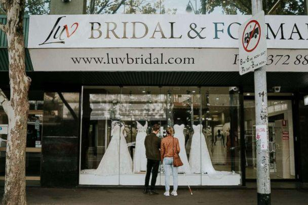 PHOTO: Blind bride Stephanie Agnew with her brother Cal at Luv Bridal in South Melbourne, Victoria, Australia. (James Day - Wedding Photographer)