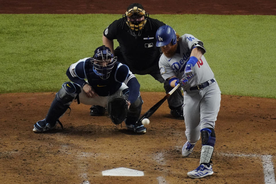 Los Angeles Dodgers' Justin Turner hits a double against the Tampa Bay Rays during the third inning in Game 3 of the baseball World Series Friday, Oct. 23, 2020, in Arlington, Texas. (AP Photo/Sue Ogrocki)