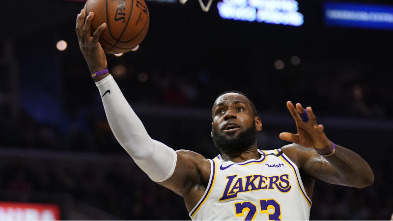 Los Angeles Lakers forward LeBron James shoots during the second half of an NBA basketball game against the Los Angeles Clippers Sunday, March 8, 2020, in Los Angeles. The Lakers won 112-103. (AP Photo/Mark J. Terrill)