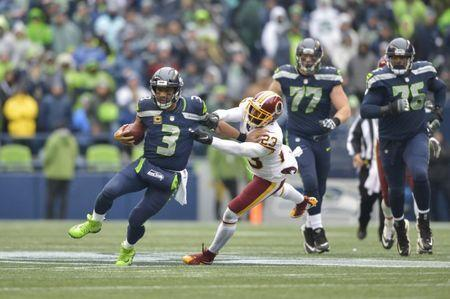 Nov 5, 2017; Seattle, WA, USA; Seattle Seahawks quarterback Russell Wilson (3) scrambles while being chased by Washington Redskins free safety DeAngelo Hall (23) during the first half at CenturyLink Field. Mandatory Credit: Steven Bisig-USA TODAY Sports