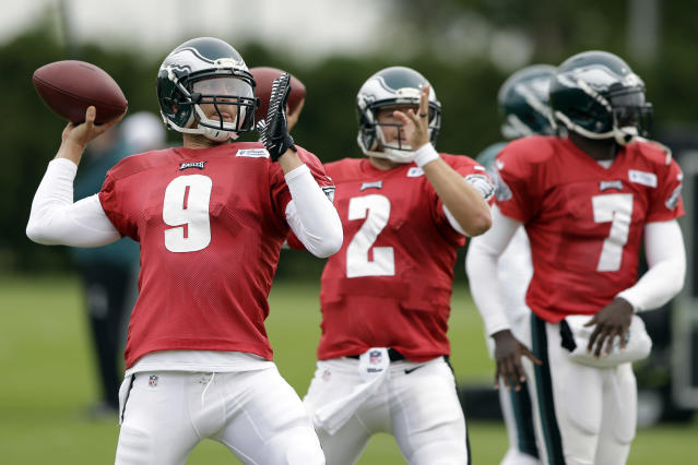 Philadelphia Eagles quarterbacks from left Nick Foles, Matt Barkley and Michael Vick throws passes during practice at the NFL football team's training facility, Wednesday, Oct. 9, 2013, in Philadelphia. Foles may get another chance to play against Tampa Bay if Vick can't go because of a hamstring injury. (AP Photo/Matt Rourke)