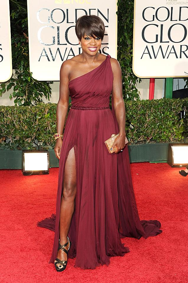 """<strong>Viola Davis</strong><br><strong>Grade: B+</strong><br><br><span style=""""font-family:Arial;"""">Best Actress nominee Viola Davis (""""The Help"""") sported a burgundy chiffon one-shoulder Emilio Pucci gown, which allowed her to a show a little leg. Davis accessorized with Fred Leighton jewels, a gold clutch, and a short<span style=""""color:#1F497D;"""">,</span> sassy 'do.</span>"""