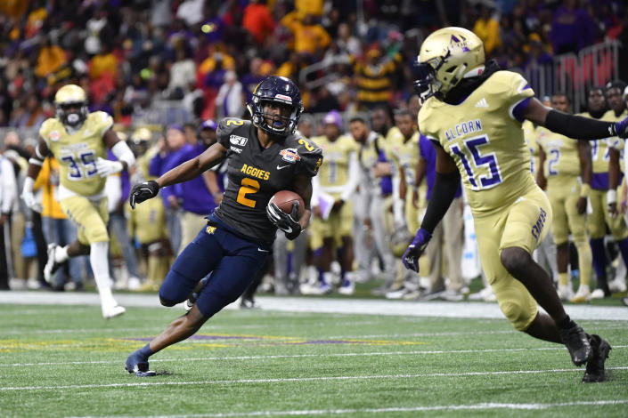 North Carolina A&T wide receiver Korey Banks (2) cuts back on Alcorn State defensive back Keyron Kinsler Jr. (15) during a long run in the second half of the Celebration Bowl NCAA college football game, Saturday, Dec. 21, 2019, in Atlanta. North Carolina A&T won 64-44. (John Amis/Atlanta Journal-Constitution via AP)