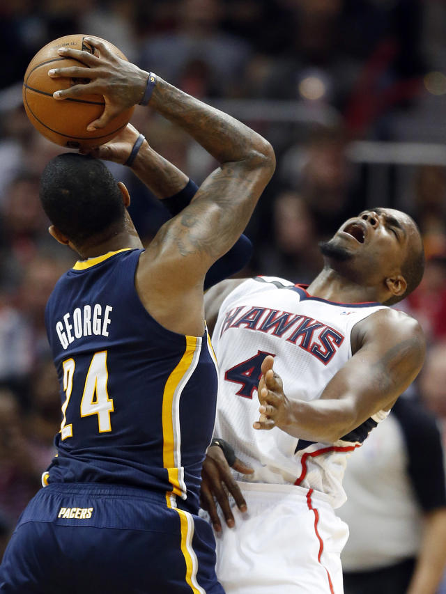 Indiana Pacers forward Paul George (24) collides with Atlanta Hawks forward Paul Millsap (4) in the second half of Game 3 of an NBA basketball first-round playoff series on Thursday, April 24, 2014, in Atlanta. The Hawks won 98-85. (AP Photo/John Bazemore)