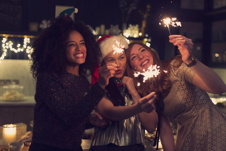 <em>Christmas partygoers are being urged to wear earplugs to protect their hearing (Picture: Getty)</em>