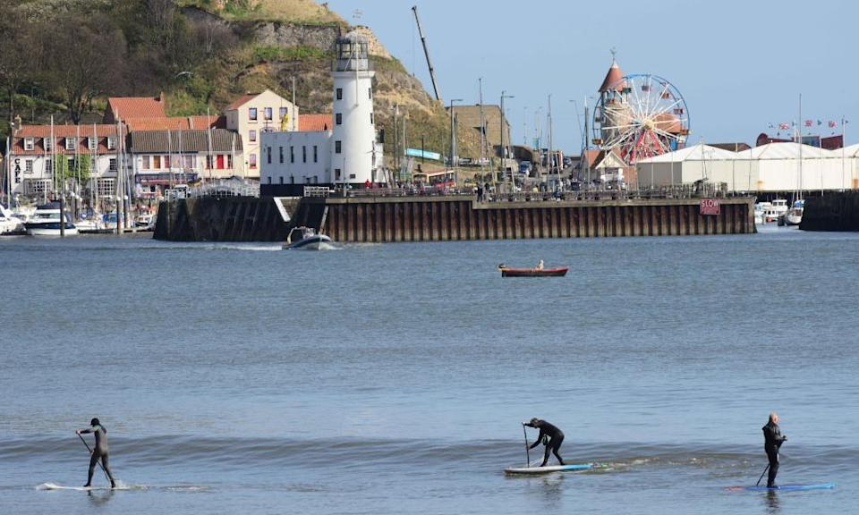 Paddleboarders in Scarborough, North Yorkshire, UK.