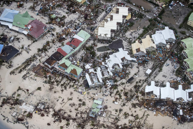 <p>Storm damage in the aftermath of Hurricane Irma, in St. Maarten. Irma cut a path of devastation across the northern Caribbean, leaving thousands homeless after destroying buildings and uprooting trees, Sept. 6, 2017. (Photo: Gerben Van Es/Dutch Defense Ministry via AP) </p>