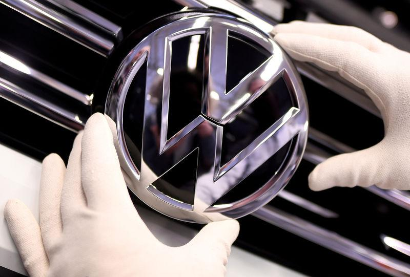 FILE PHOTO: FILE PHOTO: A Volkswagen badge on a production line at the VW plant in Wolfsburg, Germany