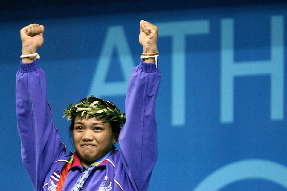 Thailand's Udomporn Polsak celebrates her gold medal in the women's 53 kg weighlifting competition at the 2004 Athens Olympics.