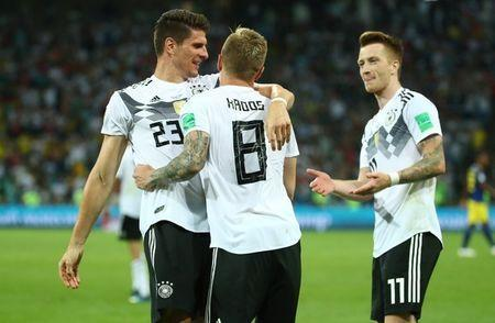 Soccer Football - World Cup - Group F - Germany vs Sweden - Fisht Stadium, Sochi, Russia - June 23, 2018 Germany's Toni Kroos celebrates scoring their second goal with Germany's Mario Gomez and Marco Reus REUTERS/Michael Dalder