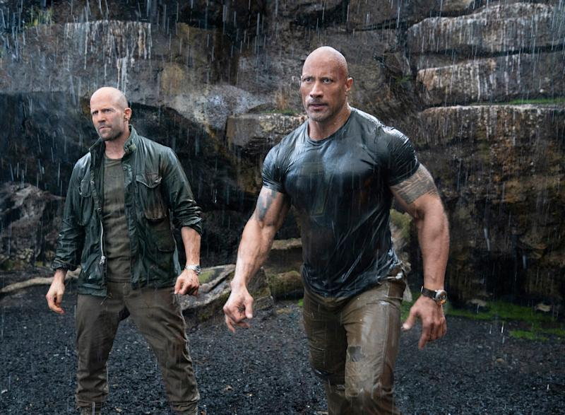 Deckard Shaw (Jason Statham, left) and Luke Hobbs (Dwayne Johnson) face a genetically enhanced villain in