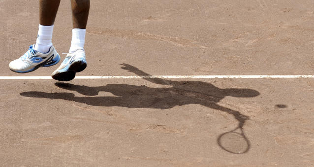 Donald Young serves the ball to Fernando Verdasco of Spain in the first set of their quarterfinal match in the U.S. Men's Clay Court Championship Friday, April 11, 2014, in Houston. (AP Photo/Pat Sullivan)
